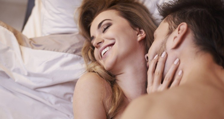man-kisssing-woman-in-neck